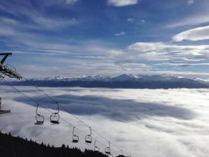 Ski lift above the cloud/fog over Innsbruck