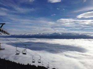 Ski lift above the cloud/fog over Innsbruck