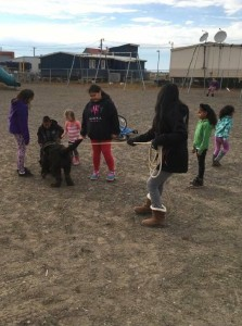 Eskimo children having more fun time with the dog.